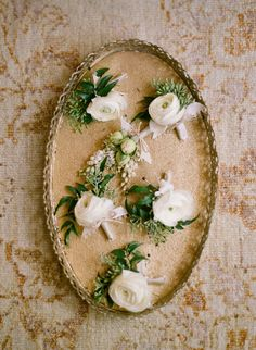 Boutonnieres by Mindy Rice. Photo by Elizabeth Messina