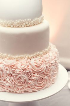 elegant blush and white wedding cake with pearl details