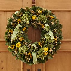 Mauve Hydrangea Phalaris Wreath    This lovely handmade wreath is made of a variety of springtime dried flowers including green caspia, salal leaves, natural flax, white globe, yellow sinuata and natural green hydrangea. Welcome spring to your home with this beautiful wreath.