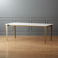 """Shop paradigm 80"""" dining table. In a modern nod to the French kitchen, marble meets industrial to dine a party of eight."""