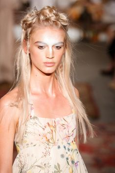 We spotted braids, pin curls, and matte bobby pins on the Houghton bridal runway. However, the standout beauty trend was the stark white face paint that covered each model's nose, brows, and forehead.