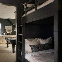 Black Built In Bunk Beds with Black Shiplap Trim: lower level guest sleeping area adjacent to the game room... You never know when you are going to get a few more visitors than you have beds!