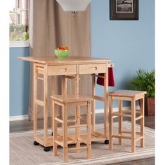 Built with an intelligent design, the Wynyard 3 Piece Pub Table Set can be used as a breakfast table or a kitchen cart. This set includes two stools and a table. The counter of the table features Drop Leaf Kitchen Island, Kitchen Island Table, Kitchen Island With Seating, Kitchen Cart, Kitchen Dining, Kitchen Islands, Kitchen Ideas, Kitchen Hacks, Pub Table Sets
