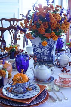 The vibrant orange and cobalt blue together is striking for a late summer, early fall arrangement