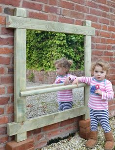 Outdoor Pull up Mirror from Designs For Education. A top quality safety mirror, ideal for outoor sensory areas.