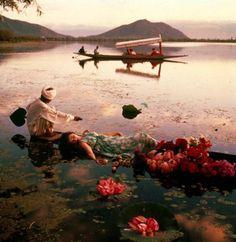 Barbara Mullen floating in Dal Lake, Kashir, shot by Norman Parkinson for Vogue, 1956