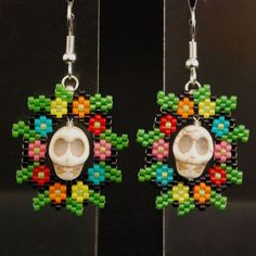 These peyote stitch earrings were inspired by colorful Day of the Dead artwork and some intriguing skull beads I found in a local shop. Skull Earrings, Beaded Earrings, Halloween Beads, Halloween Earrings, Halloween Jewelry, Peyote Patterns, Beading Patterns, Day Of The Dead Artwork, Peyote Beading