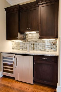 mirrored subway tile back splash - bar -- But with white cabinets! Love this