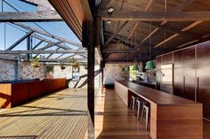 15 abandoned warehouses that were transformed into totally habitable homes // rooftop deck and exposed kitchen