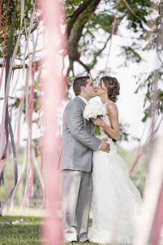 Ribbons / streamers in the trees, very effective, pretty and not expensive! Fabulous!