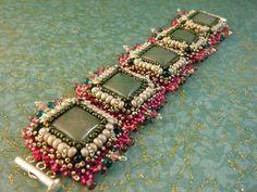 Crimson Frog Mossy pink bead embroidery tile bracelet SALE. $95.00, via Etsy.