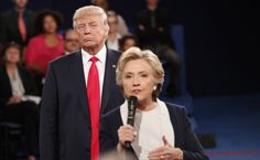 """Trump listens as Democratic nominee Hillary Clinton answers a question from the audience during their second debate on October 9. He was later criticized for """"lurking"""" behind her."""