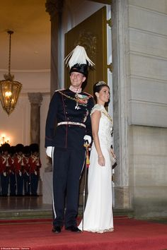 1/1/16.   Prince Joachim, 46, also wore traditional military regalia for the event and was pictured beaming as he made his entrance with his wife Princess Marie