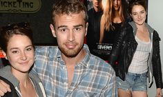 Divergent's Shailene Woodley and Theo James hug at film screening