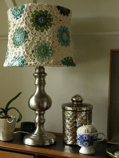 Either this or the green glass lamp- I'm leaning toward doing something similar to this using bright green and blue for the centers of the motifs, and bright white for the edges. Probably a simple clear glass or white lamp base.