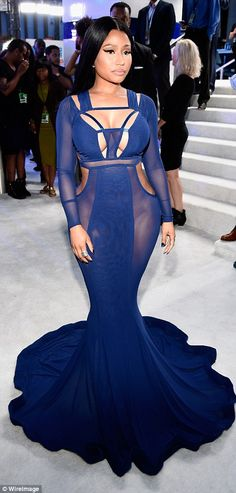 Killer curves: Large sheer portions of the dress revealed the rapper didn't…