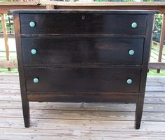 refinished dresser - i like the idea of the colored knobs, instead of painting the dresser a color
