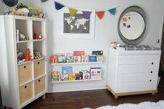 Sebastian's Nursery, book wall, picture ledges, Ikea expedit with legs