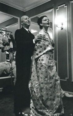 Ava Gardner being fitted for a gown by Christian Dior.