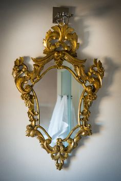 May 2013 Issue - A gilded mirror hung against a white wall
