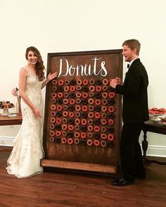 When your groom has a serious love for donuts, you surprise him will a wall of them We pulled it off @caitiebeth ! #willyoubeline #donutwall Venue: @serraplaza Planning: @greenappleeventco Catering: @sundriedtomatobistro Photographer: @joshelliott Videographer: @honeybunchco DJ: @voxdjs Florist: @floraloccasions Dessert: @susiecakesbakery + @thedonuttery