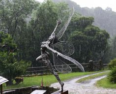 FantasyWire by Robin Wight. I just love this picture! Look at the water/rain drops in the background.