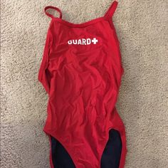 One piece life guard swim suit. Bright red one piece life guard swimsuit. Size…