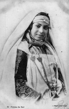 Africa | Woman from the south.  Algeria || Vintage postcard; publisher J Geiser.  No 62.