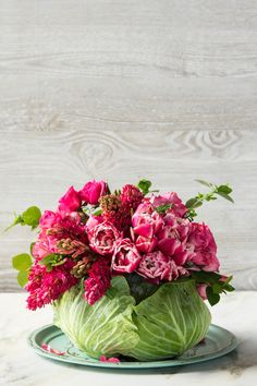 This Colorful Cabbage Centerpiece - 9 DIY Projects You Need to Try This Spring - Southernliving. The perfect centerpiece for Mother's Day or for spring parties. The cabbage is unexpected, but so easy. Instructions here.
