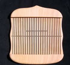 Image result for double holed rigid heddle