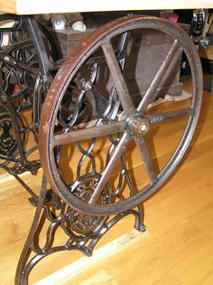 Wheel of an Antique Singer Sewing Machine with foot-powered lathe.