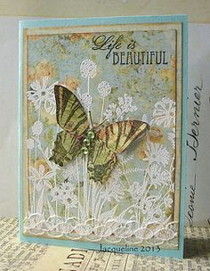 love the idea of the white embossing on top of the decorative paper....a beautiful card with the butterfly adding depth  tfs