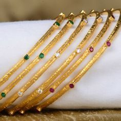 Contemporary-styled set of six bangles features diamonds, rubies and emeralds handcrafted in 18 karat yellow gold. Gold Bangles Design, Gold Jewellery Design, Gold Jewelry, Bangle Set, Bangle Bracelets, Silver Bracelets, Mehndi, Bracelet Cartier, India Jewelry