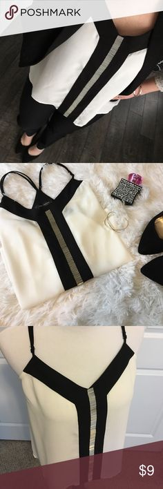Black and White Embellished Racerback Tank New without tags and never worn! White flowy tank top with adjustable straps and silver bead embellishment on the front. Classy enough to wear with a blazer to the office and stylish enough to wear by itself for a night out! Tops Blouses