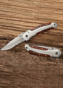 Give the outdoorsman in your wedding party a gift he will absolutely love with our Personalized Sport Knife. One look at the handsome rosewood handle secured with solid brass pins and you know you're getting an authentic knife crafted with supreme quality. This knife features both a serrated edge on the bottom for tearing through hard to cut surfaces and a smooth blade on top for accurate and precise slicing. When this blade is opened and fully extended you'll hear a distinct clicking sound…