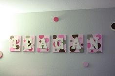 creative name boards....   could make them magnetic! can use canvas boards wrapped with fabric