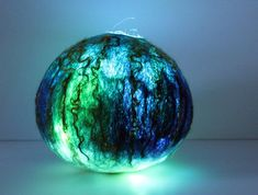 A gorgeous felt orb, with LED lights to make it glow with a soft light at night. Hand felted using a combination of Merino and English Leicester sheeps wool, this is a unique piece. By day it looks a little like a ceramic vase and by night, with the addition of LED lights, a soft glow