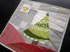 I love everything about this.  It is modern with a hint of traditional.  And it has meaning.  That star and the quilting just draws you in.  Love this.