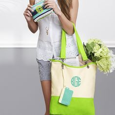Easy on the eye, this tote's new color blocking feature adds that pop of color you'll love!