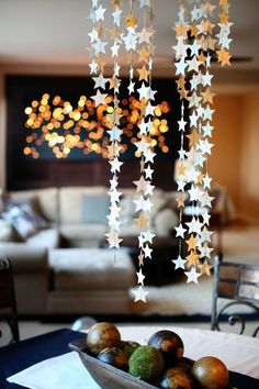 I love these hanging stars. I wish i had a punch so i could just punch them out though that is a lot of c I love these hanging stars. I wish i had a punch so i could just punch them out though that is a lot of cutting. Indoor Christmas Decorations, Ramadan Decorations, Christmas Crafts, Christmas Ornaments, Christmas Christmas, Christmas Ideas, Birthday Table, Birthday Parties, Table Settings