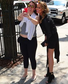 Selfie time: The wife of John Legend did not hesitate to pose for a picture with a female fan on the street
