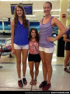 UCF two tallest volleyball players and shortest cheerleader. This doesn't even look real.