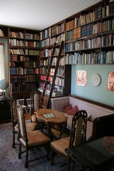 Personal Library. This WILL happen. Or else. And it must have a fireplace and a little tea table and comfy red plush chairs and stuff[: