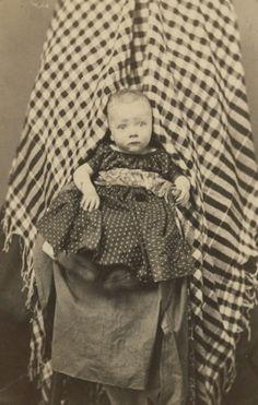 ca. 1860s, ['hidden mother' carte de visite portrait of a child] via KaufmaNelson Vintage Photographs