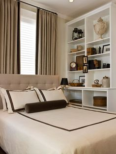 A quiet, neutral palette keeps this small guest bedroom feeling light and inviting, while a pared-down display of favorite artifacts on the built-in bookshelves adds a touch of interest for both looks and conversation.