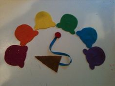 Buttoning ice cream cone: Felt triangle for cone, 6 colors of ice cream scoops; sew a button to one end of a ribbon and the triangle to the other end. Perfect for fine motor work, visual sequencing (matching a pattern) or auditory sequencing.