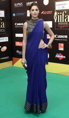High Neck Blouse with Saree is the right thing that works for thin women to get a fuller appeal