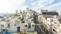 "Japanese studio Akihisa Hirata Architecture Office has completed a mixed-use building in Tokyo featuring a jumbled composition of concrete rooms that create spaces for small balconies and gardens. Akihisa Hirata stacks concrete boxes to create ""futuristic and savage"" Tree-ness House"