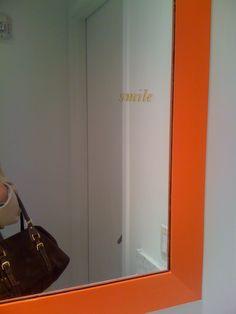 A Tiny Little Smile On The Side Of Huge Framed Mirror Kate Spade Showroom