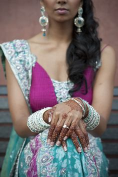 We love the beautiful details that go into a Indian wedding. Photo by Studio This Is